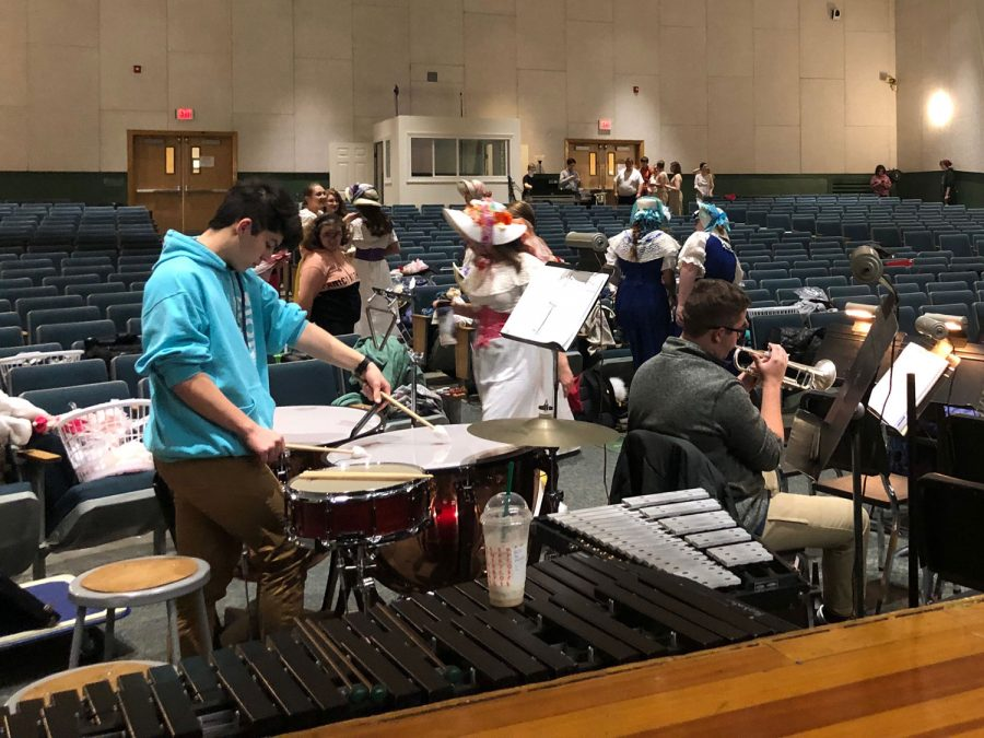 Members+of+the+pit+orchestra+warm+up+and+get+ready+for+the+first+%22Tech+Week%22+rehearsal.+Tech+Week+is+one+week%2C+%28or+three+days%29%2C+when+the+musical+is+perfected+by+the+cast%2C+crew+and+pit+orchestra.+%22I%E2%80%99m+excited+for+it+to+all+really+come+together+%E2%80%98cause+that%E2%80%99s+always+the+best+part.+Knowing+that+you+made+a+quality+show+happen.%22+Senior+actress+Bailey+Marlowe+said.