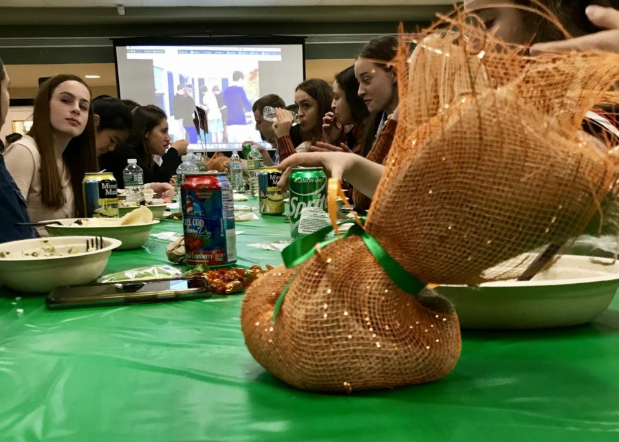 Runners from both the boys and girls cross country team dine together before listening to the coaches give speeches and hand out awards. Coach Jennifer Fairbanks gave a speech detailing a long list of team and personal achievements this season, as well as times.