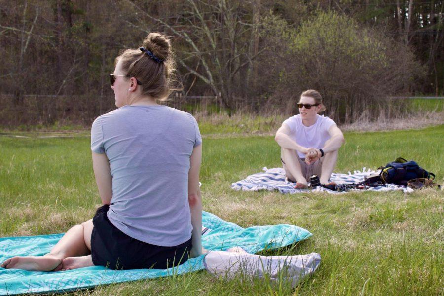 Teens enjoy the warm weather 6 feet apart.