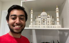 Inside his bedroom, Devansh stands next to his impressive LEGO constructions. His largest LEGO set, the Taj Mahal, took him almost 6 hours to build.