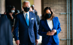 "President Biden Stands next to Vice President Harris. Biden said he hopes to restore unity in his Inaugural adress. ""And we'll lead not merely by the example of our power, but by the power of our example"" Biden said."