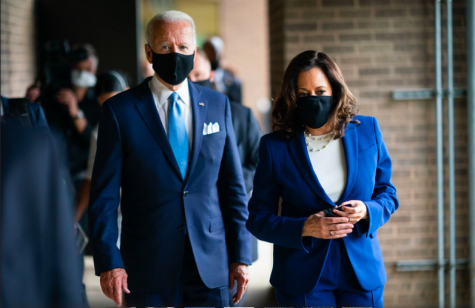 "President Biden Stands next to Vice President Harris. Biden said he hopes to restore unity in his Inaugural adress. ""And we"