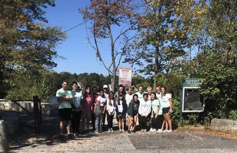 Environmental awareness club combines with UNITE to help clean up Sandy Beach.